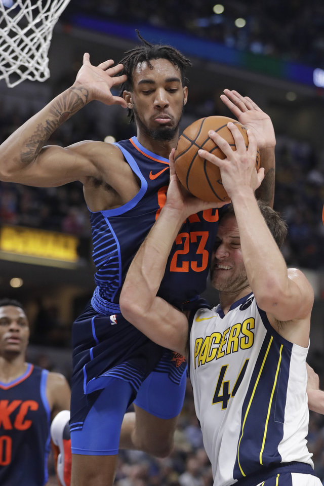 Photo - Indiana Pacers' Bojan Bogdanovic (44) is fouled by Oklahoma City Thunder's Terrance Ferguson (23) as he goes up for a shot during the second half of an NBA basketball game, Thursday, March 14, 2019, in Indianapolis. Indiana won 108-106. (AP Photo/Darron Cummings)