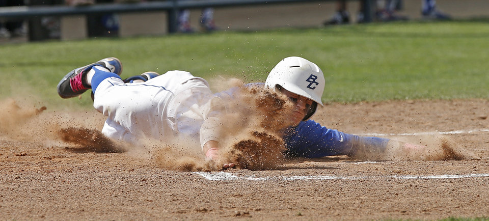 Berryhill's Christian Davidson slides home in the first inning of the Class 4A state baseball tournament championship game against Plainview in Shawnee, Okla., Saturday, May 11, 2013. Photo by Bryan Terry, The Oklahoman