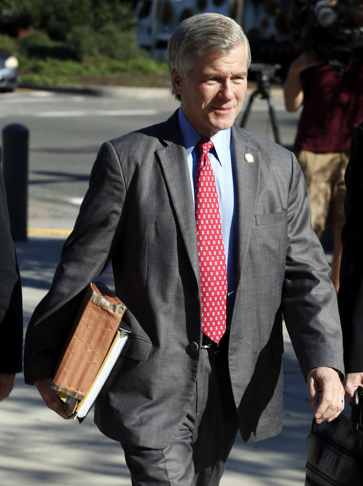 Photo - Former Virginia Gov. Bob McDonnell arrives at federal court  Wednesday, Aug. 27, 2014, in Richmond, Va.  The defense in his corruption case is expected to rest today. McDonnell and his wife, Maureen, are charged with accepting more than $165,000 in gifts and loans from former Star Scientific Inc. CEO Jonnie Williams in exchange for promoting his company's dietary supplements.  (AP Photo/Steve Helber)