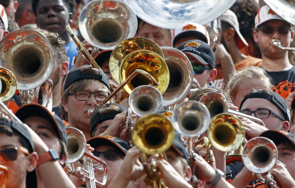 Photo - Oklahoma State band member Garrett Morgan plays his trombone with the Oklahoma State band during the first half of an NCAA college football game against Texas, Saturday, Oct. 21, 2017, in Austin, Texas. (AP Photo/Michael Thomas)