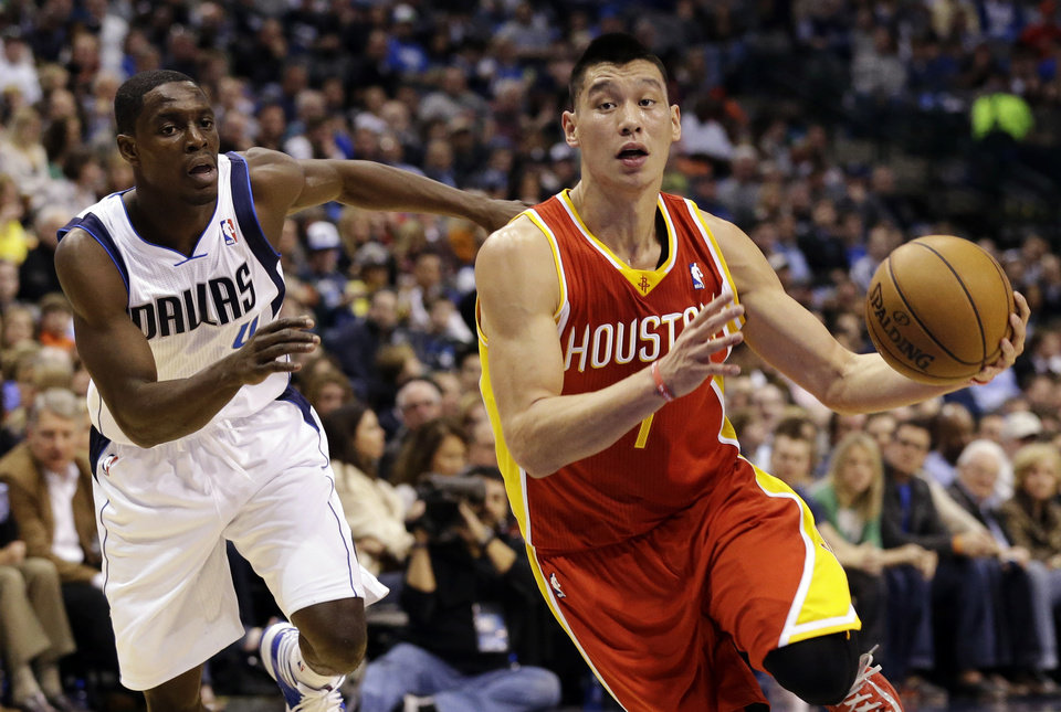 Houston Rockets guard Jeremy Lin (7) drives by Dallas Mavericks' Darren Collison (4) in the first half of an NBA basketball game, Wednesday, March 6, 2013, in Dallas. (AP Photo/Tony Gutierrez)