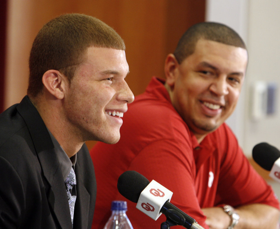 Photo - University of Oklahoma basketball star Blake Griffin announces he will leave the Sooner team for the NBA professional draft in Norman, Okla. on Tuesday, April 7, 2009.   At right is head coach Jeff Capel.