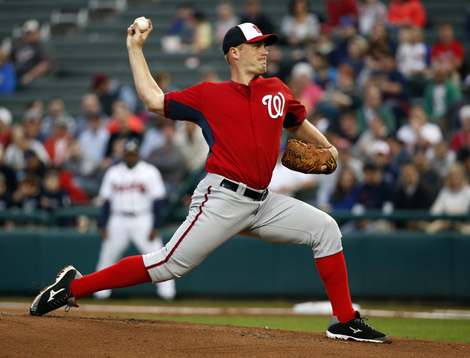 Photo - Washington Nationals starting pitcher Jordan Zimmermann throws in the first inning of a spring exhibition baseball game against the Atlanta Braves, Thursday, March 6, 2014, in Kissimmee, Fla. (AP Photo/Alex Brandon)