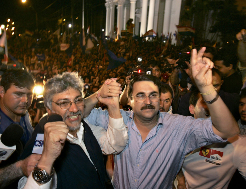 Photo -   FILE - In this April 20, 2008 file photo, presidential candidate Fernando Lugo, left, and his running mate Federico Franco wave to supporters as they campaign in Asuncion, Paraguay. An impeachment process ended with the ouster of Lugo on Friday, June 22, 2012. The Senate tried him on five charges of malfeasance in office, including an alleged role in a deadly confrontation between police and landless farmers that left 17 dead. Lugo will be replaced by Vice President Federico Franco. (AP Photo/Jorge Saenz, File)