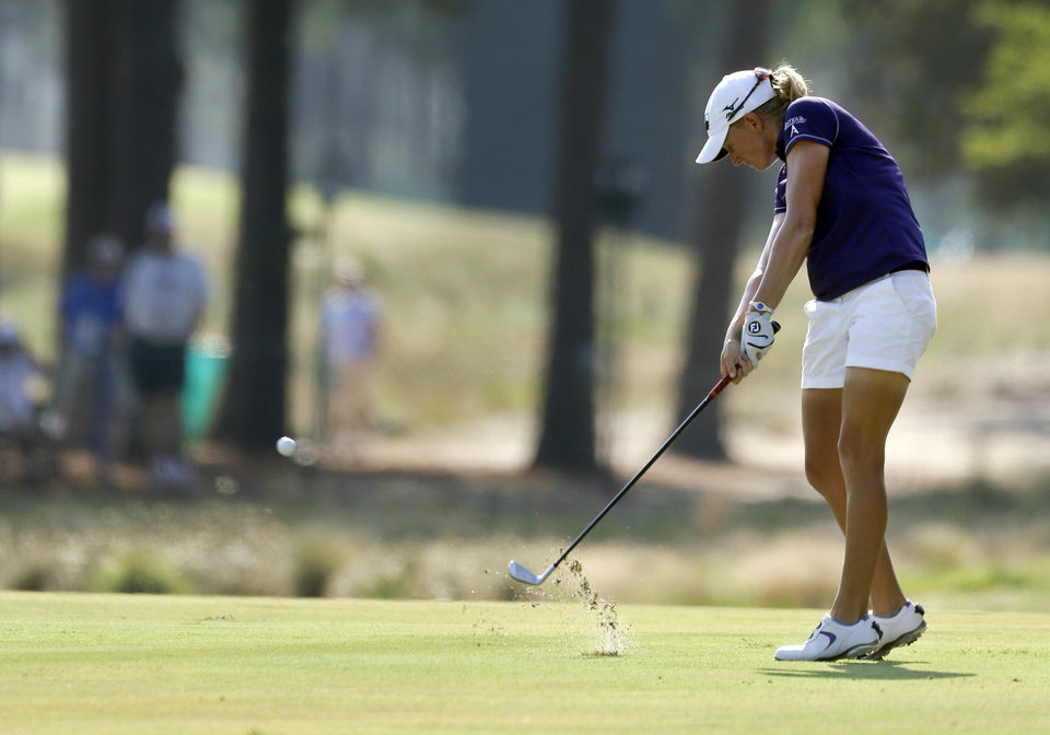 Photo - Stacy Lewis hits her approach shot on the 13th fairway during the first round of the U.S. Women's Open golf tournament in Pinehurst, N.C., Thursday, June 19, 2014. (AP Photo/Bob Leverone)