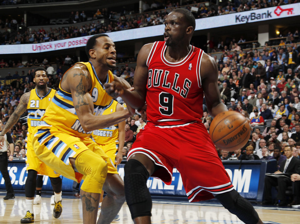 Photo - Chicago Bulls forward Luol Deng, right, of the Sudan, works ball inside against Denver Nuggets guard Andre Iguodala in the second quarter of an NBA basketball game in Denver on Thursday, Feb. 7, 2013. (AP Photo/David Zalubowski)