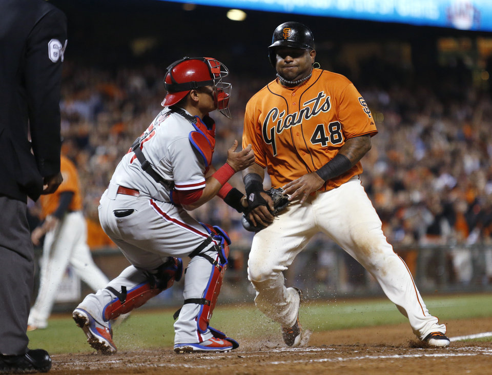 Photo - San Francisco Giants' Pablo Sandoval is tagged out at home plate by Philadelphia Phillies catcher Carlos Ruiz during the eighth inning of a baseball game, Friday, Aug. 15, 2014, in San Francisco. (AP Photo/Beck Diefenbach)