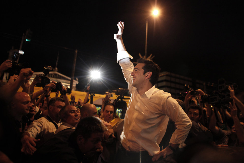 Photo -   Left Coalition party leader Alexis Tsipras waves to supporters in central Athens after elections on Sunday, May 6, 2012. Tsipras was projected to come second in the poll, behind the front-runner conservatives, on a pledge to cancel Greece's bailout agreements. (AP Photo/Kostas Tsironis)