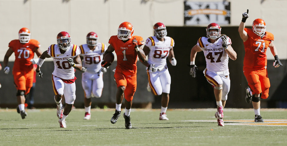 Photo - Oklahoma State's Joseph Randle (1) leaves behind Iowa State's Jacques Washington (10), Cleyon Laing (90), David Irving (87) and A.J. Klein (47), as well as teammates Jonathan Rush (70) and Parker Graham (71) on a 62-yard carry in the fourth quarter during a college football game between Oklahoma State University (OSU) and Iowa State University (ISU) at Boone Pickens Stadium in Stillwater, Okla., Saturday, Oct. 20, 2012. OSU won, 31-10. Photo by Nate Billings, The Oklahoman