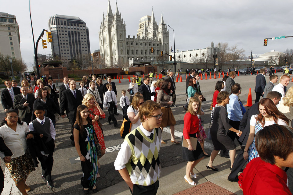 Photo - People walk to the Conference Center before the start of the 183rd Annual General Conference of The Church of Jesus Christ of Latter-day Saints on Saturday, April 6, 2013, in Salt Lake City.  The Church of Jesus Christ of Latter-day Saints is planning to build two new temples in Rio de Janeiro and Cedar City, Utah, the president of the Mormon church announced Saturday. Thomas S. Monson made the announcement in his opening address to more than 100,000 members of the church who've gathered in Salt Lake City for the church's 183rd semi-annual general conference.  (AP Photo/Rick Bowmer)