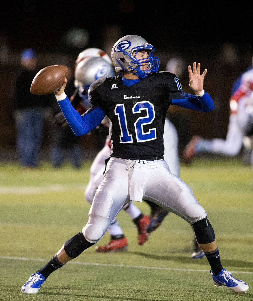 Photo - Guthrie quarterback Reed Roberts (12) throws a pass during the class 5A high school playoffs between Collinsville and Guthrie at Sapulpa HS on November 29, 2013.   JOEY JOHNSON/For the Tulsa World