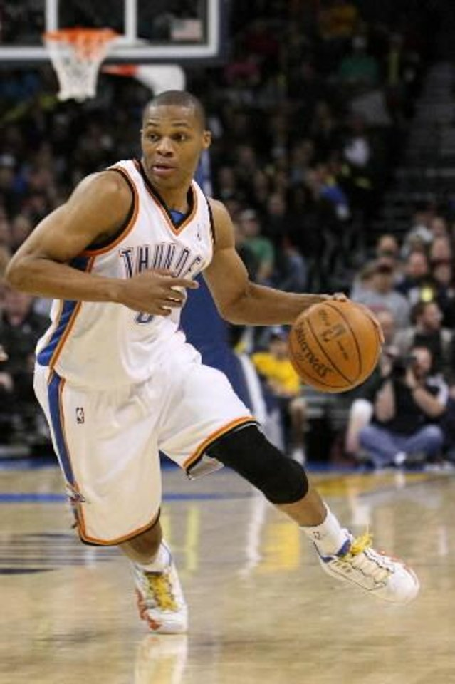 Photo - Oklahoma City Thunder guard  Russell  Westbrook drives to the basket during the Thunder - Celtics game December 4, 2009 in the Ford Center in Oklahoma City. BY HUGH SCOTT