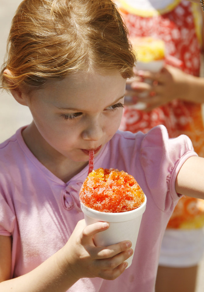 Lily Arnold, 6, enjoys a snow cone on East Lindsay in Norman, Okla. on Tuesday, May 19, 2009    Photo by Steve Sisney, The Oklahoman