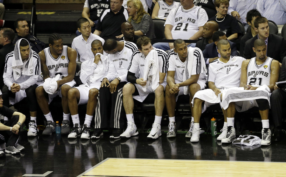 Photo - The San Antonio Spurs watches during the second half at Game 4 of the NBA Finals basketball series against Miami Heat, Thursday, June 13, 2013, in San Antonio. The Heat won 109 - 93. (AP Photo/David J. Phillip)