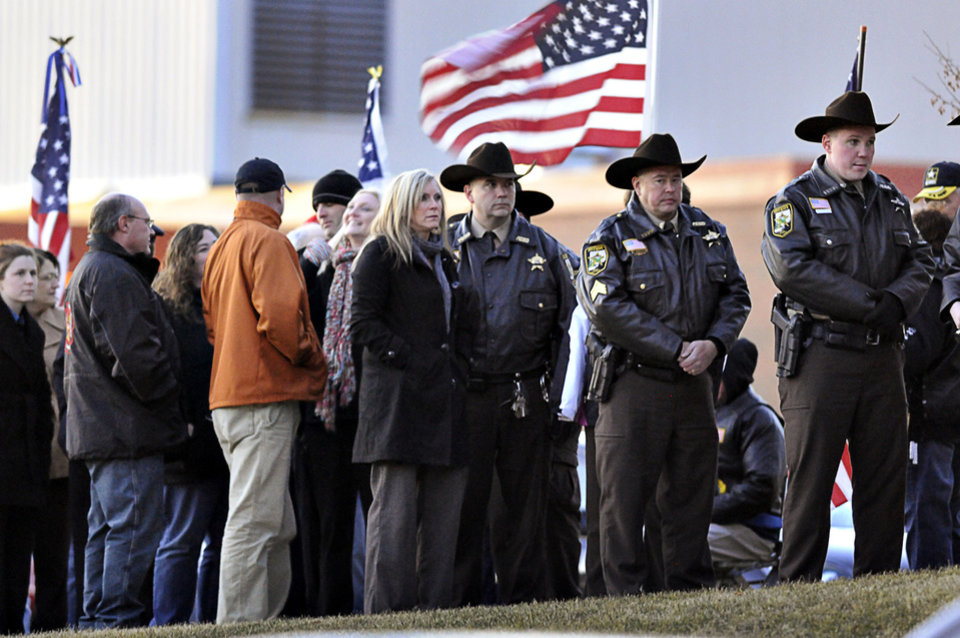 People were lined along the front of St. Boniface Catholic Church in Cold Spring, Minn., to pay their respects during a visitation for Cold Spring-Richmond Police Officer Tom Decker, Tuesday, Nov. 4, 2012. The investigation into the killing of Decker in Cold Spring continues, and authorities were still looking for the 20-gauge shotgun that is believed to be the murder weapon, officials said. (AP Photo/St. Cloud Times, Jason Wachter)