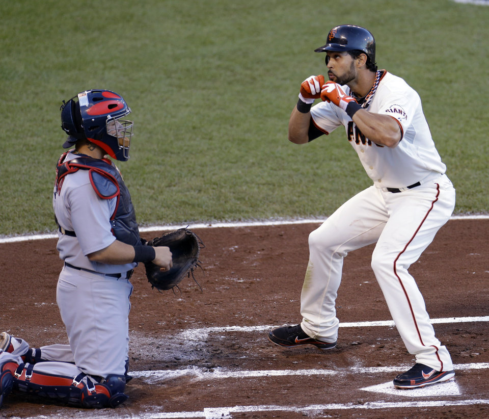 Photo -   San Francisco Giants' Angel Pagan celebrates in front of St. Louis Cardinals catcher Yadier Molina after Pagan hit a home run during the first inning of Game 2 of baseball's National League championship series Monday, Oct. 15, 2012, in San Francisco. (AP Photo/Eric Risberg)