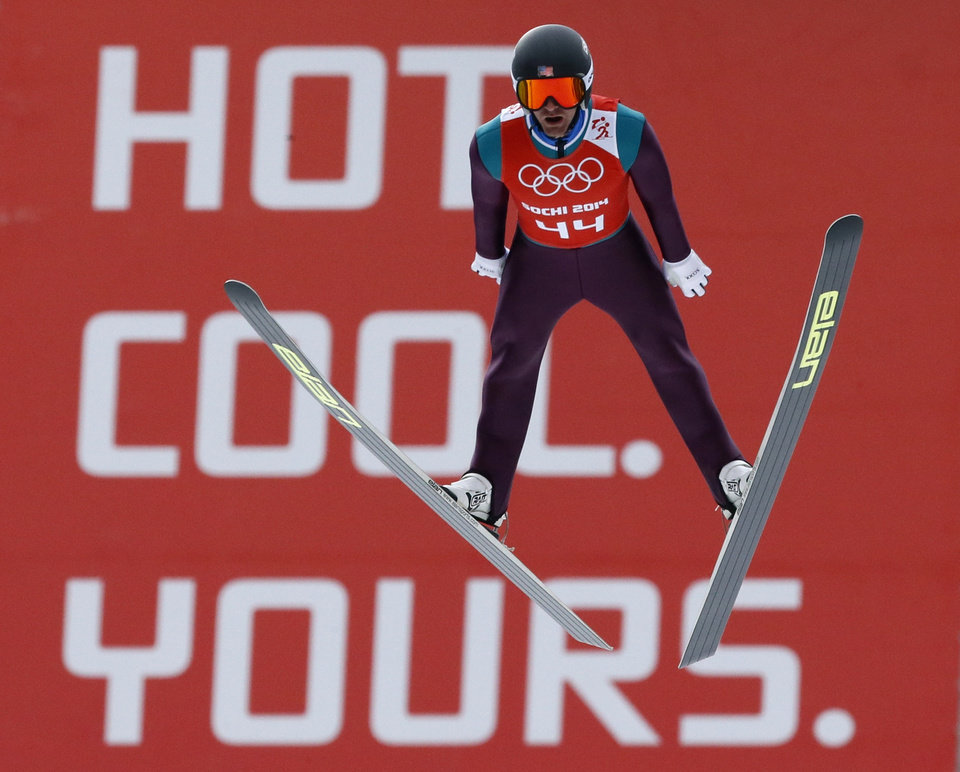 Photo - Bryan Fletcher of the United States soars through the air during a men's nordic combined training session at the 2014 Winter Olympics, Tuesday, Feb. 11, 2014, in Krasnaya Polyana, Russia. (AP Photo/Dmitry Lovetsky)