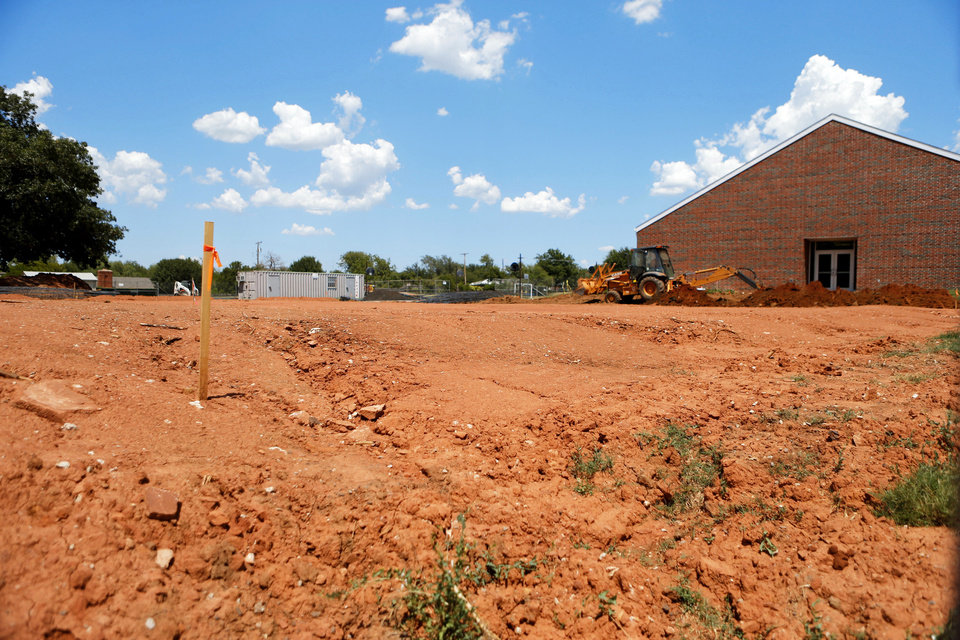 Photo - Construction equipment sits idle on the proposed site of a new gym at Nichols Hills Elementary. School district officials are investigating why the gym is being built on a different spot than originally planned. Photos by Bryan Terry, The Oklahoman