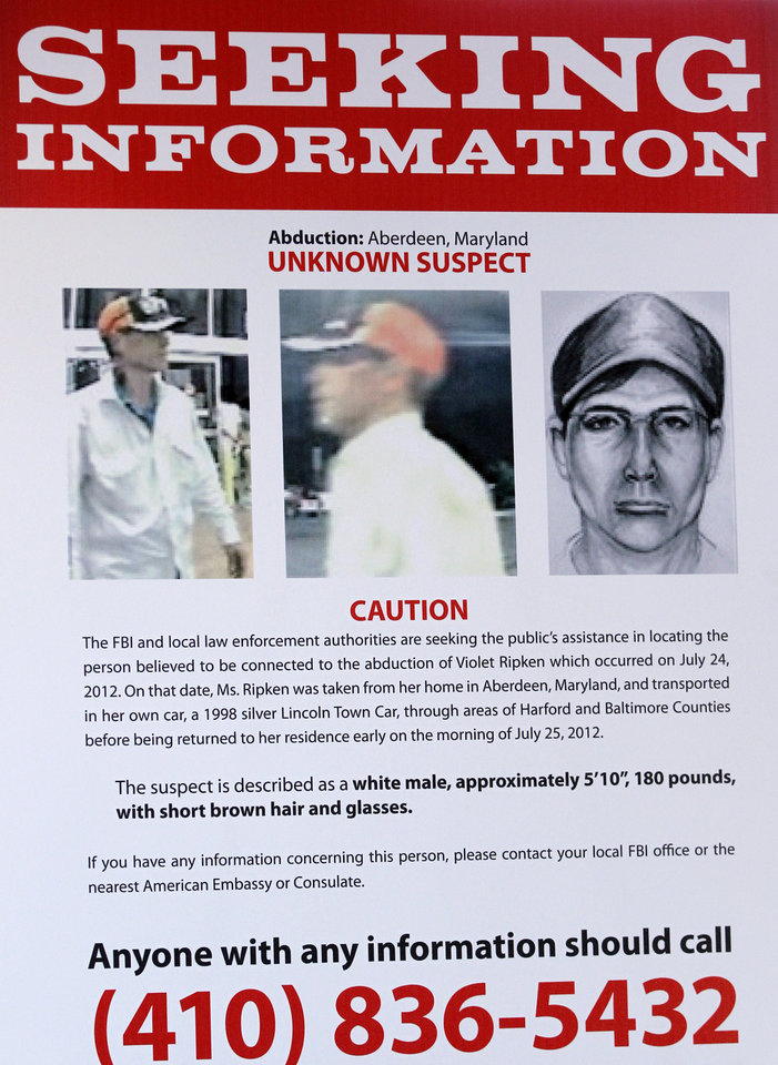 Photo -   A wanted poster of an unknown suspect being sought in connection with the abduction of Vi Ripken is shown during a news conference in Baltimore, Friday, Aug. 3, 2012. Cal Ripken Jr. appealed for the public's help in locating the man responsible for kidnapping his 74-year-old mother at gunpoint. Vi Ripken was found unharmed in her car, but Ripken says she remains shaken up and is too traumatized to return home. (AP Photo/Jose Luis Magana)