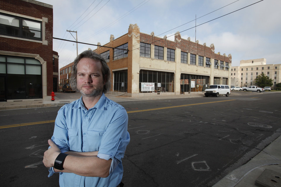 Architect Brian Fitzsimmons in front of the Guardian Garage in Oklahoma City, Monday  September  17, 2012. Photo By Steve Gooch, The Oklahoman <strong>Steve Gooch - The Oklahoman</strong>