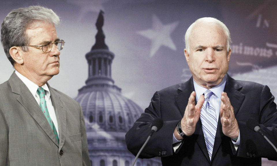 Photo - Sen. John McCain, right, accompanied by Sen. Tom Coburn, gestures during a news conference Tuesday.  AP PHOTO