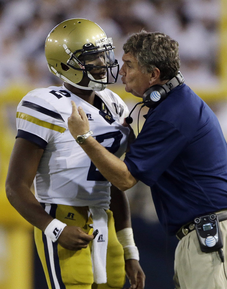 Photo - Georgia Tech head coach Paul Johnson, right, speaks to quarterback Vad lee (2) in the second half of an NCAA college football game against Virginia Tech, Thursday, Sept. 26, 2013, in Atlanta. (AP Photo/John Bazemore)