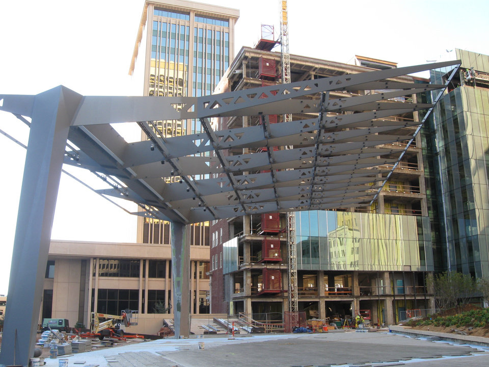CONSTRUCTION: A large steel pavilion now connects the 29-story SandRidge Tower with the Braniff Building, which is getting a new modern glass facade on the former alley side of the 11-story building. PHOTO BY STEVE LACKMEYER, THE OKLAHOMAN    ORG XMIT: 1211052225198737