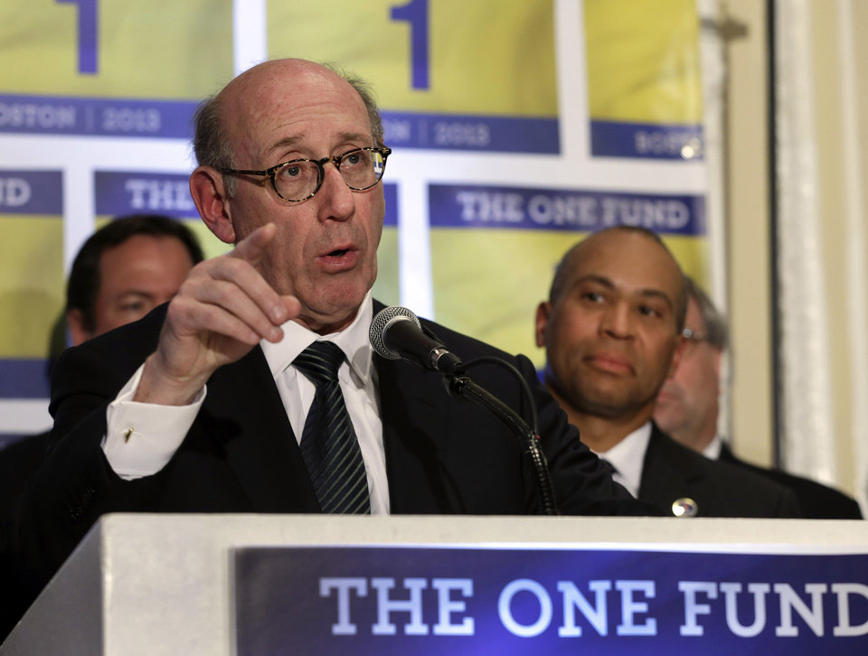 FILE - In this Tuesday April 23, 2013 file photo, Kenneth Feinberg, an attorney who managed the 9/11 Victim Compensation Fund, speaks at a news conference in Boston, as Massachusetts Gov. Deval Patrick listens at right. Feinberg will design and be administrator of a new fund to help people affected by the Boston Marathon bombing. Patrick and Boston Mayor Thomas Menino say the One Fund Boston is intended as a central place to gather donations for the Boston Marathon bombing victims. (AP Photo/Elise Amendola, File)