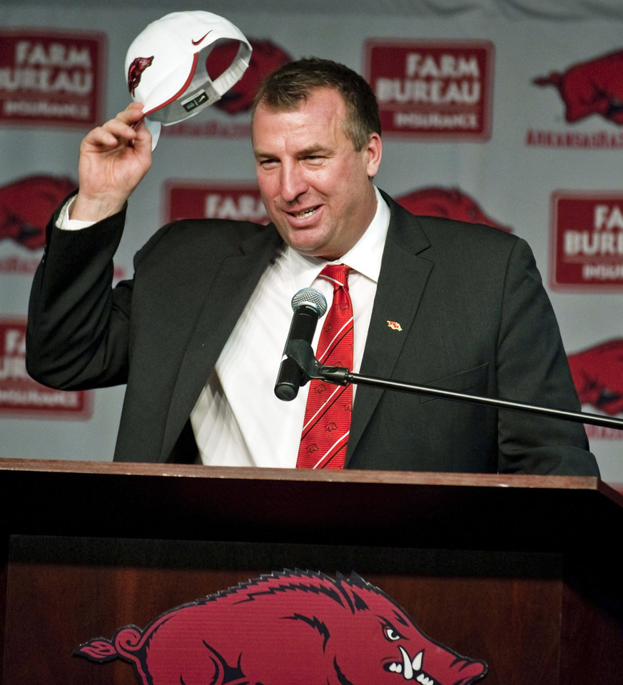 New Arkansas head coach Bret Bielema takes off his cap after being introduced during an NCAA college football news conference in Fayetteville, Ark., Wednesday, Dec. 5, 2012. Bielema, who will be paid $3.2 million annually for six years, replaces interim coach John L. Smith, who was hired after Bobby Petrino was fired in April. (AP Photo/April L. Brown)
