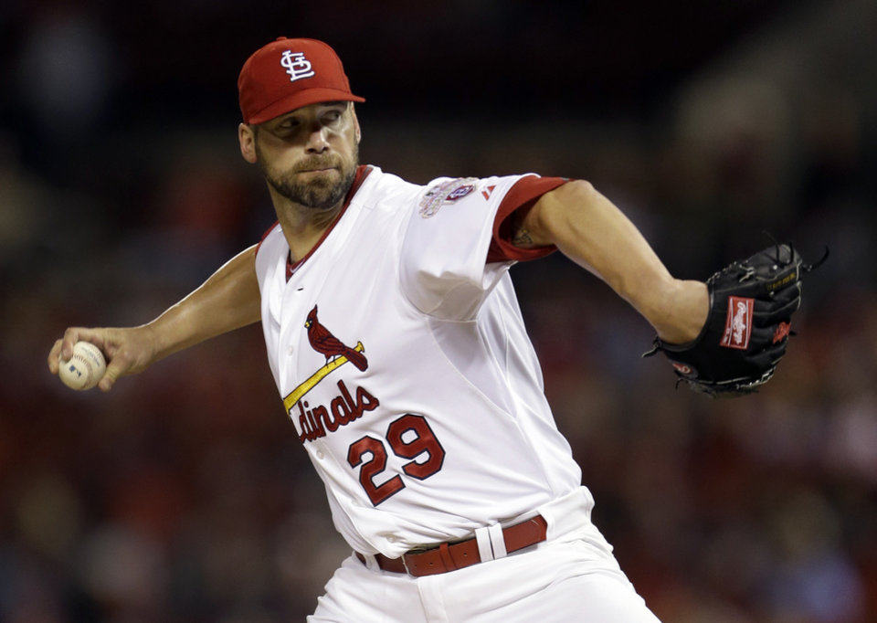 St. Louis Cardinals starting pitcher Chris Carpenter throws during the first inning of a baseball game against the Cincinnati Reds, Tuesday, Oct. 2, 2012, in St. Louis. (AP Photo/Jeff Roberson)