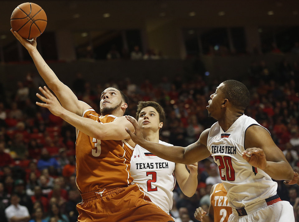Photo - Texas' Javan Felix shoots ahead of Texas Tech's Dusty Hannahs (2) and Toddrick Gotcher (20) during their NCAA college basketball game in Lubbock, Texas, Saturday, Mar, 8, 2014. (AP Photo/Lubbock Avalanche-Journal, Zach Long) ALL LOCAL TV OUT