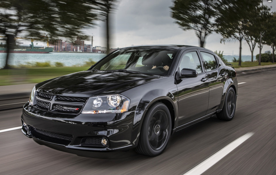 Photo - This undated image made available by Chrysler shows the 2013 Dodge Avenger Blacktop Edition. (AP Photo/Chrysler)