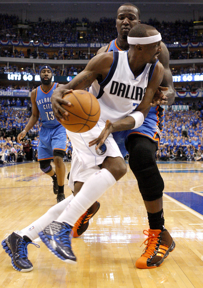 Photo - Oklahoma City's Kendrick Perkins (5) defends Jason Terry (31) of Dallas during game 1 of the Western Conference Finals in the NBA basketball playoffs between the Dallas Mavericks and the Oklahoma City Thunder at American Airlines Center in Dallas, Tuesday, May 17, 2011. Photo by Bryan Terry, The Oklahoman