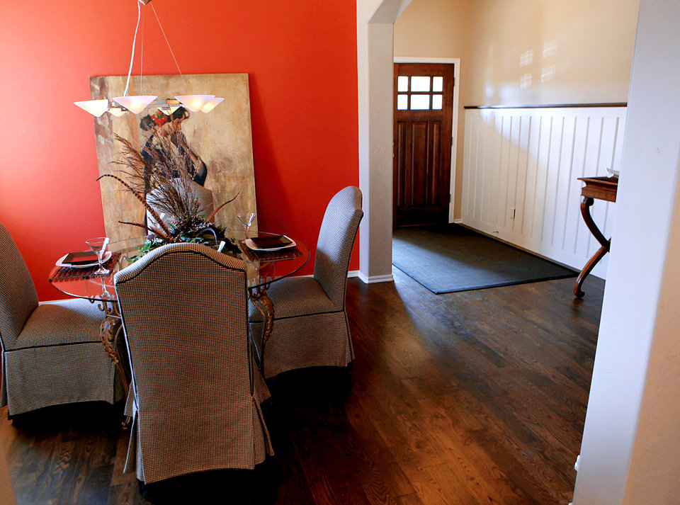 Photo - The dining area and entry are shown in a model home called The Hemingway in Caleb McCaleb's Arbor Creek addition of bungalows in Edmond.  Photo by John Clanton, The Oklahoman
