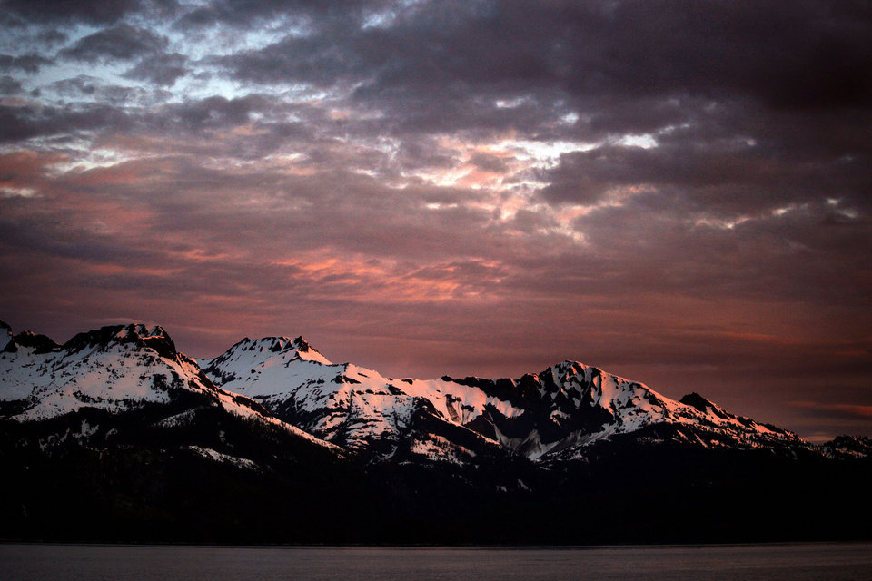 Photo - The sun rises over a mountain range in Southeast Alaska, Tuesday, June 5, 2012.  Photo by Sarah Phipps, The Oklahoman