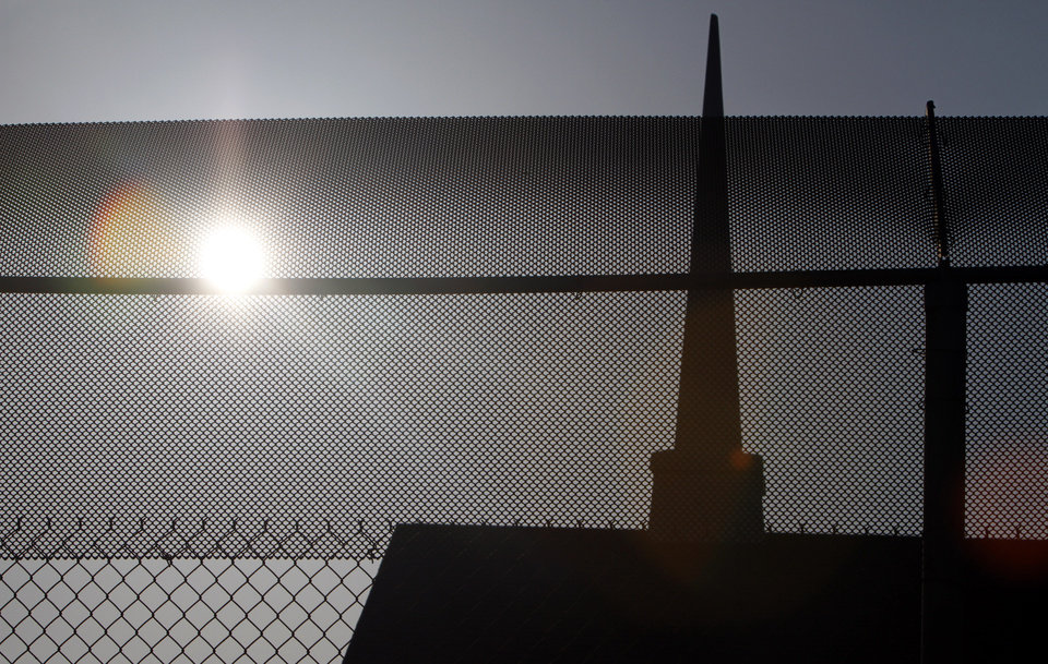 Photo - CHURCH / PRISON: The chapel at Eddie  W. Warrior Correctional Center is seen through fencing, Sunday, March 28, 2010, in Taft, Okla. Photo by Sarah Phipps, The Oklaho ORG XMIT: KOD