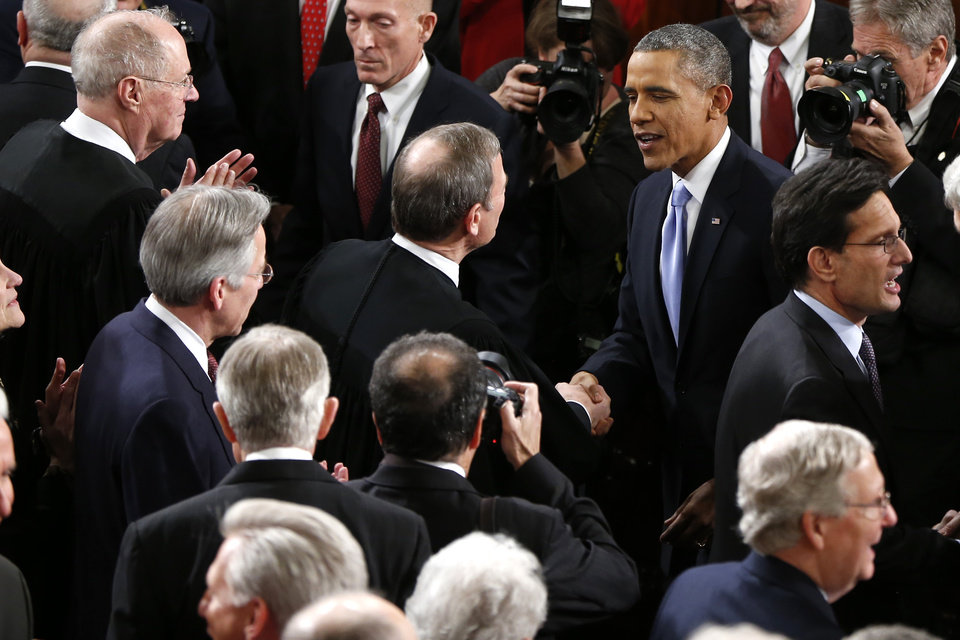 Photo - Chief Justice John Roberts greets President Barack Obama before the president gave his State of the Union address on Capitol Hill in Washington, Tuesday Jan. 28, 2014. (AP Photo/Charles Dharapak)