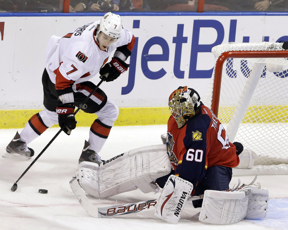 Ottawa Senators center Kyle Turris (7) shoots on Florida Panthers goalie Jose Theodore (60) during the second period of an NHL hockey game, Thursday, Jan. 24, 2013, in Sunrise, Fla. (AP Photo/Wilfredo Lee)