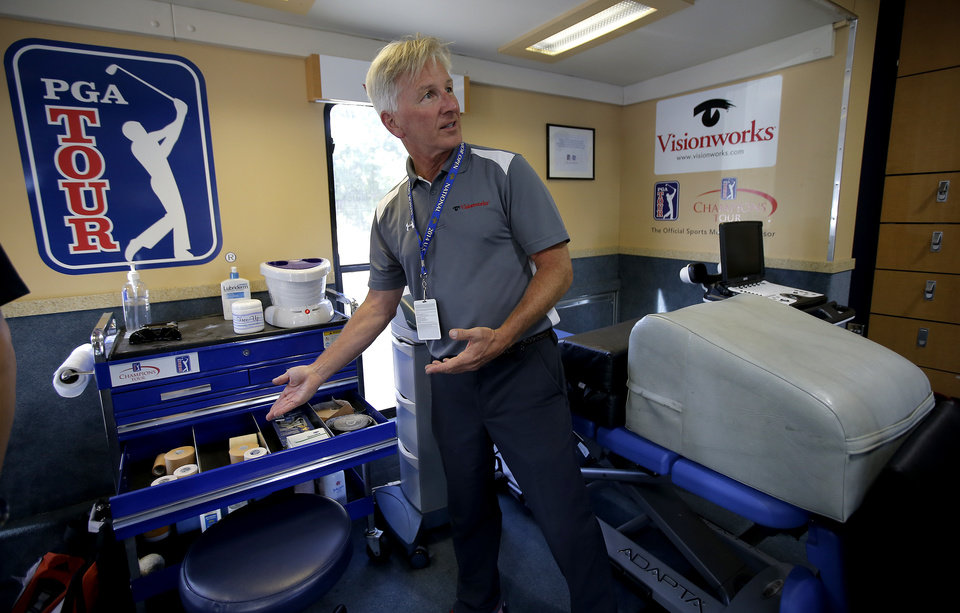 Photo - Physical therapist Paul Schueren talks about the amenities inside a training trailer for tour players during the U.S. Senior Open at Oak Tree National in Edmond, Okla., Tuesday, July 8, 2014. Photo by Bryan Terry, The Oklahoman
