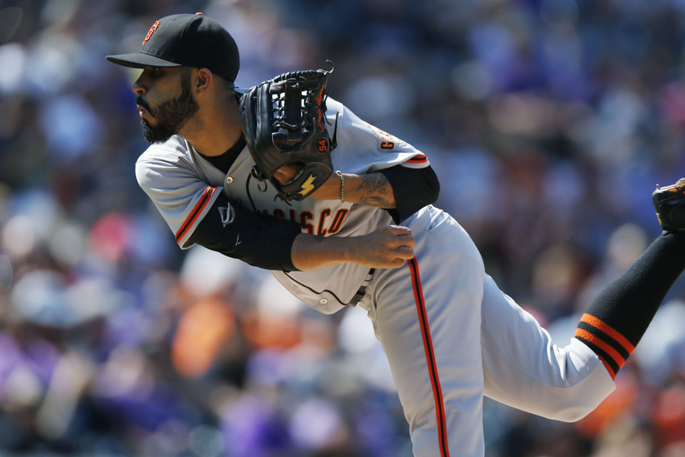 Photo - San Francisco Giants relief pitcher Sergio Romo works against the Colorado Rockies in the eighth inning of the Giants' 4-2 victory in a baseball game in Denver on Monday, Sept. 1, 2014. The game was resumed in the bottom of the sixth inning of play when it was suspended because of rain on May 22. (AP Photo/David Zalubowski)