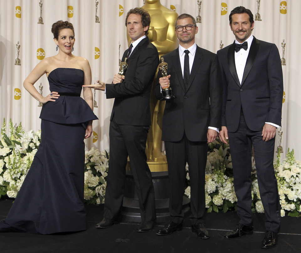 ** EMBARGOED AT THE REQUEST OF THE ACADEMY OF MOTION PICTURE ARTS & SCIENCES FOR USE UPON CONCLUSION OF THE ACADEMY AWARDS TELECAST **Kirk Baxter, second from left, and Angus Wall, second from right, pose with presenters Tina Fey, left, and Bradley Cooper, and their awards for best achievement in film editing during the 84th Academy Awards on Sunday, Feb. 26, 2012, in the Hollywood section of Los Angeles. (AP Photo/Joel Ryan) ORG XMIT: ACATS152