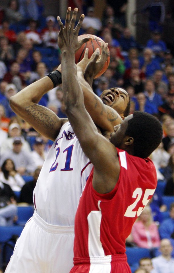 Photo - Markieff Morris (21) of Kansas tries to get a shot past Patrick Hazel (25) of Boston in the second half during the NCAA men's basketball tournament second round game between Boston and Kansas at the BOK Center in Tulsa, Okla., Friday, March 18, 2011. Kansas won, 72-53. Photo by Nate Billings, The Oklahoman