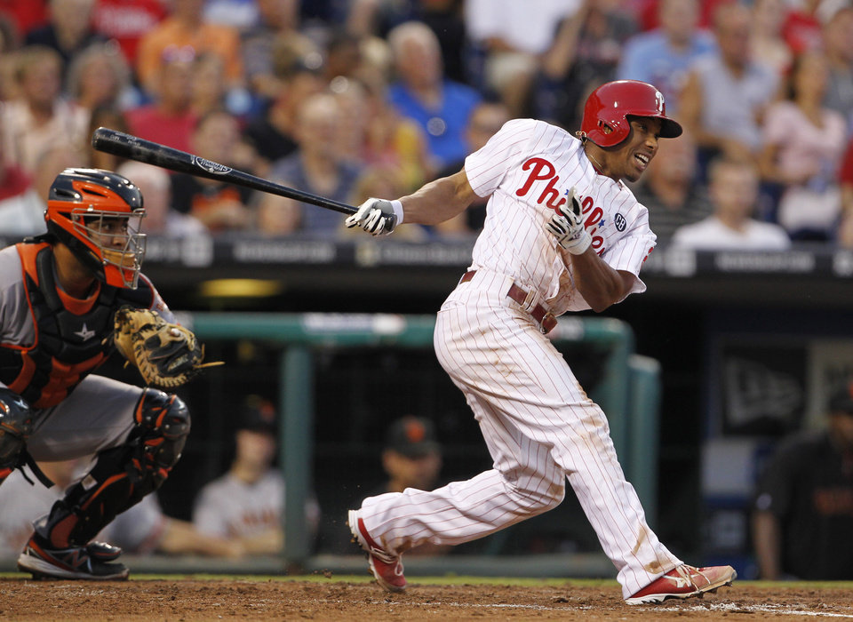 Photo - Philadelphia Phillies' Ben Revere gets a hit in the third inning of a baseball game against the San Francisco Giants, Tuesday, July 22, 2014, in Philadelphia. (AP Photo/The Philadelphia Inquirer, Ron Cortes)