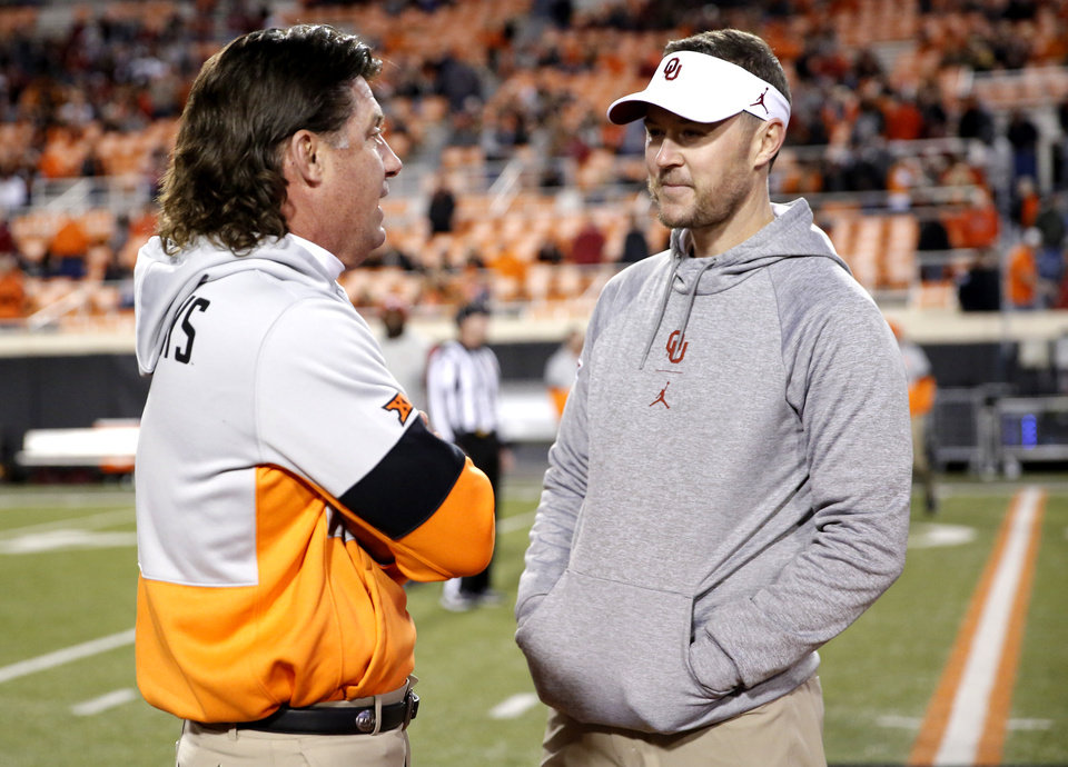 Photo - Oklahoma State head coach Mike Gundy and Oklahoma head coach Lincoln Riley talk before the Bedlam college football game between the Oklahoma State Cowboys (OSU) and Oklahoma Sooners (OU) at Boone Pickens Stadium in Stillwater, Okla., Saturday, Nov. 30, 2019. OU won  34-16. [Sarah Phipps/The Oklahoman]