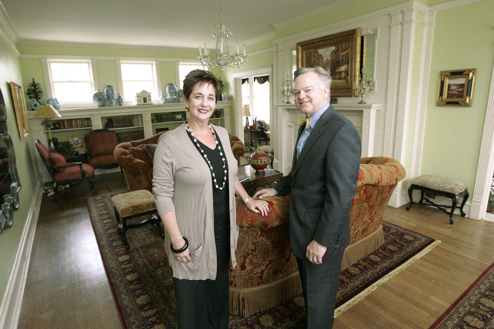 Photo - Glenna Tanenbaum and Mike McAuliffe, co- chairmen of the Symphony Designers Show House, stand in the main living room of the home at 431 NW 17 in Oklahoma City's Heritage Hills neighborhood. PHOTO BY STEVE GOOCH, THE OKLAHOMAN