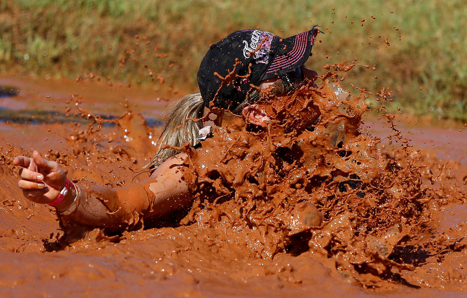 Delilah McGaha falls in the mud during the 11th Annual MUDD Volleyball Tournament benefiting MDA of Central Oklahoma in Mustang, Okla., Saturday, July 21, 2012. Photo by Bryan Terry, The Oklahoman