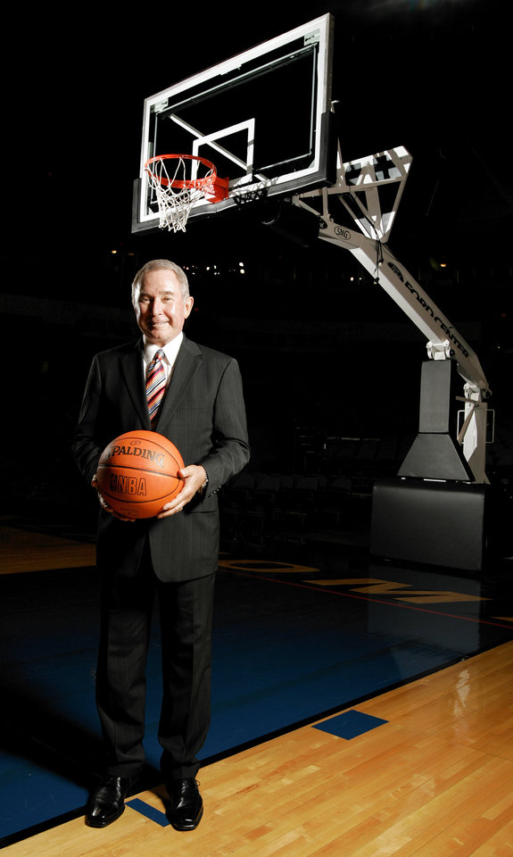 Photo - George Shinn, owner of the New Orleans / Oklahoma City  Hornets NBA basketball team, poses for a photograph at the Ford Center in Oklahoma City, September 27, 2005. Oklahoma City's Ford Center will be the home for the Hornets during the upcoming 2005-06 season. By Nate Billings/The Oklahoman
