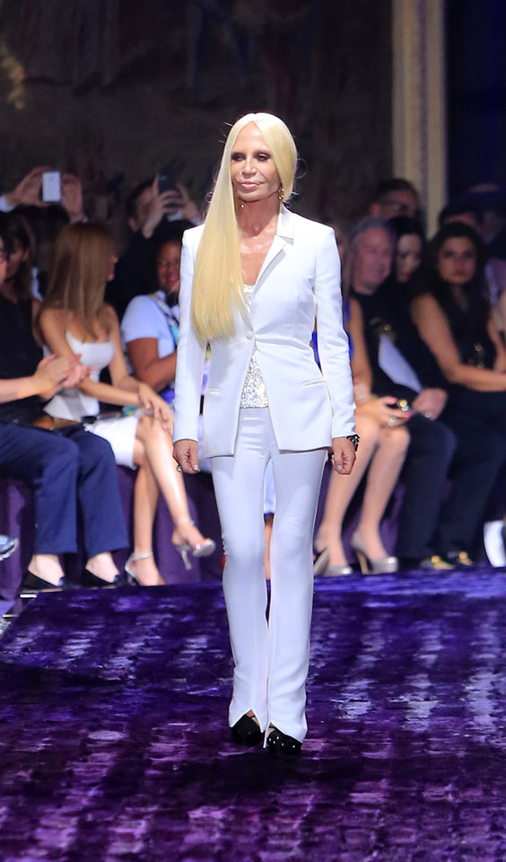 Photo - Italian fashion designer Donatella Versace appears following the presentation of the Atelier Versace Fall Winter 2014-15 Haute Couture fashion collection, Sunday, July 6, 2014, in Paris.  (AP Photo/Jacques Brinon)