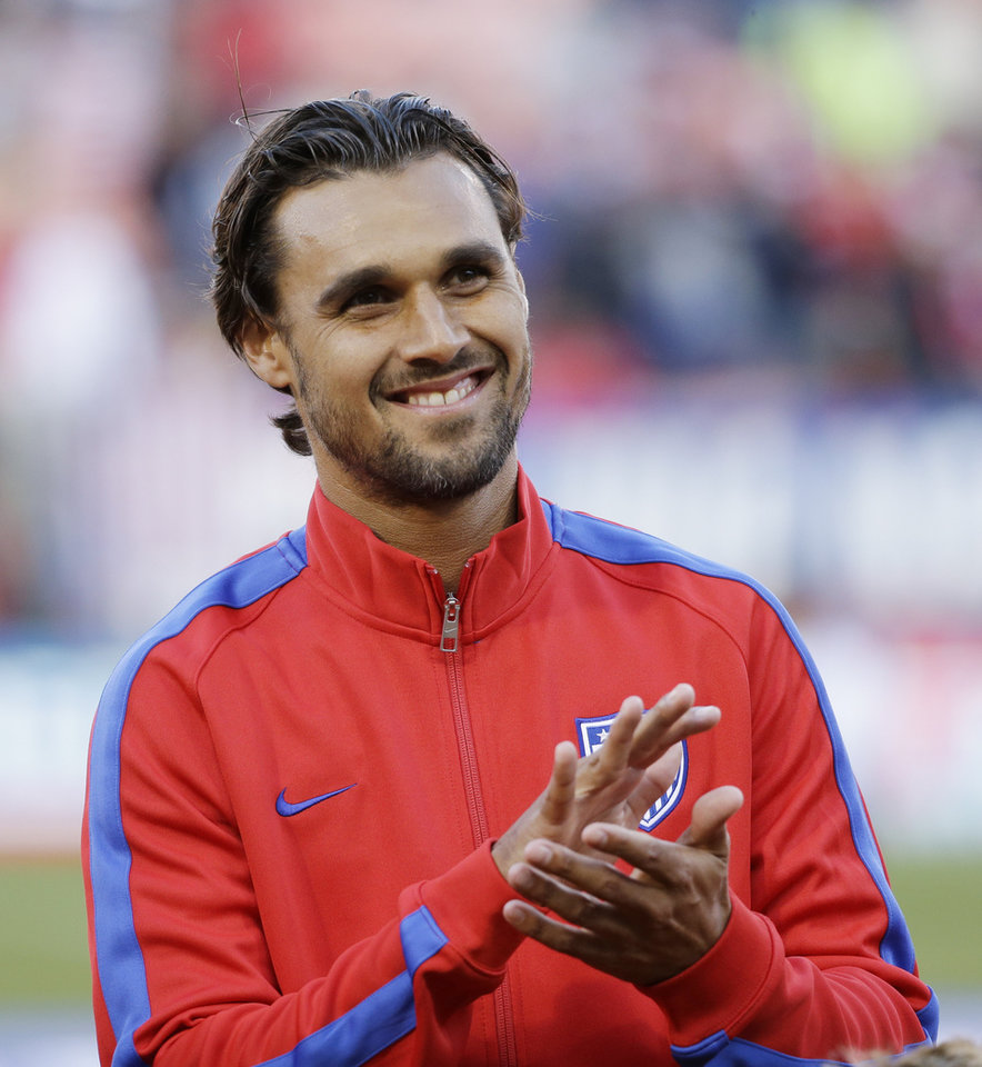 Photo - United States' Chris Wondolowski is introduced before an international friendly soccer match against Azerbaijan on Tuesday, May 27, 2014, in San Francisco. (AP Photo/Marcio Jose Sanchez)
