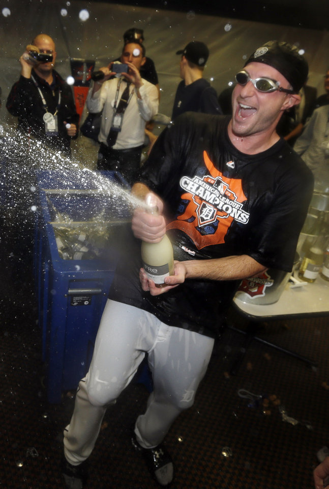 Photo -   Detroit Tigers' Max Scherzer celebrates in the locker room after his team won Game 4 of the American League championship series 8-1, against the New York Yankees, Thursday, Oct. 18, 2012, in Detroit. The Tigers move on to the World Series. (AP Photo/Paul Sancya)